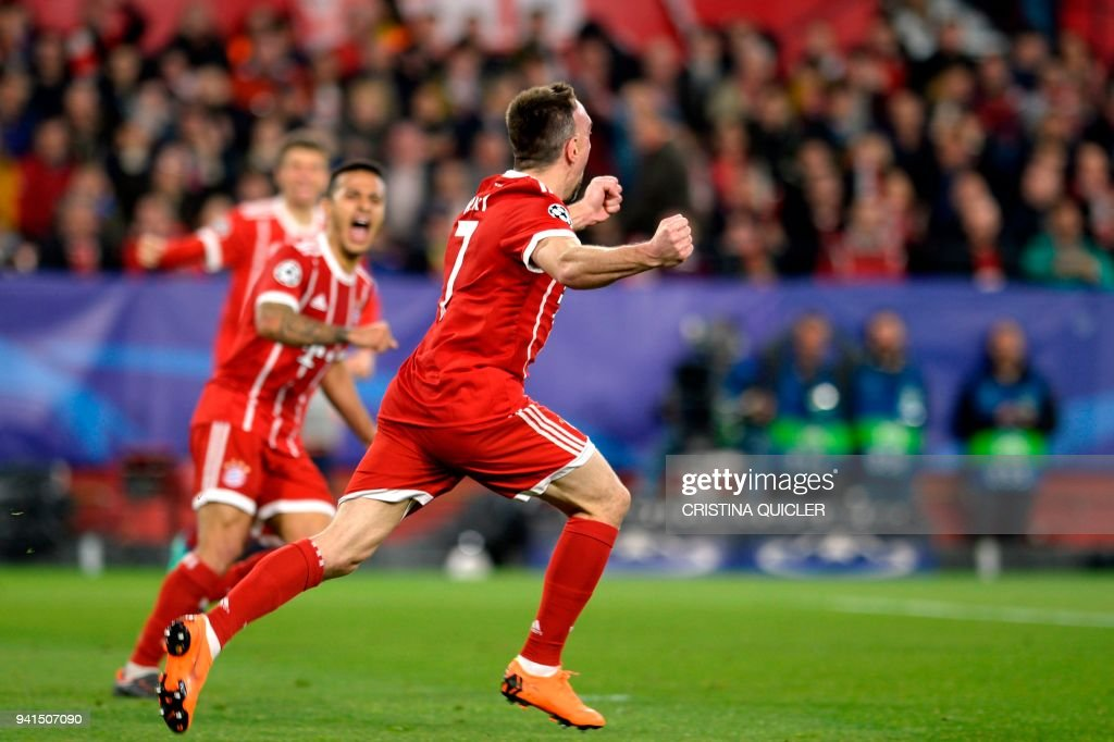 Bayern Munich's French midfielder Franck Ribery celebrates Sevilla's Spanish midfielder Jesus Navas' own goal during the UEFA Champions League quarter-final first leg football match between Sevilla FC and Bayern Munich at the Ramon Sanchez Pizjuan Stadium in Sevilla on April 3, 2018. /