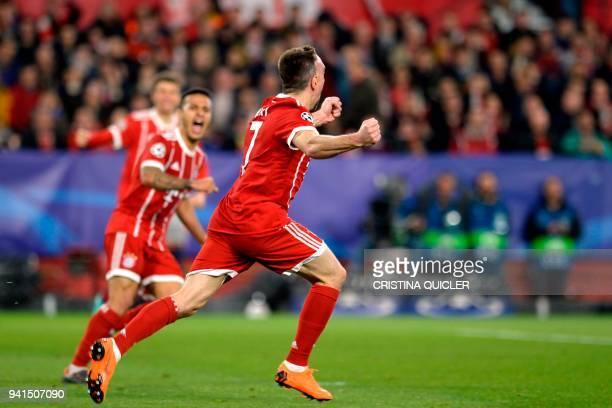 Bayern Munich's French midfielder Franck Ribery celebrates Sevilla's Spanish midfielder Jesus Navas' own goal during the UEFA Champions League...