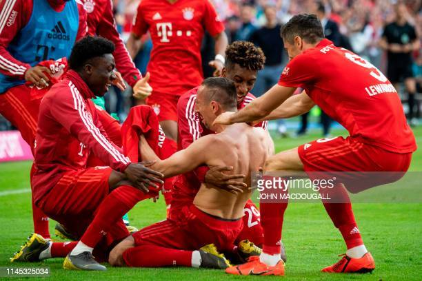 TOPSHOT Bayern Munich's French midfielder Franck Ribery celebrates with teammates after scoring during the German first division Bundesliga football...