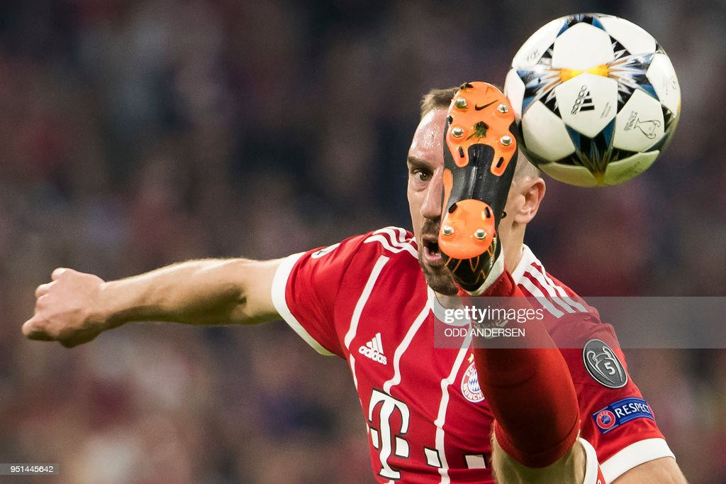 TOPSHOT - Bayern Munich's French midfielder Franck Ribery controls the ball during the UEFA Champions League semi-final first-leg football match FC Bayern Munich v Real Madrid CF in Munich, southern Germany on April 25, 2018.