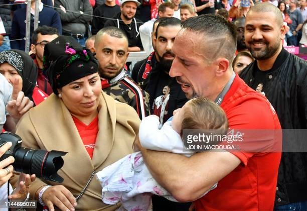 Bayern Munich's French midfielder Franck Ribery holds his baby next to his wife Wahiba Ribery after the German First division Bundesliga football...