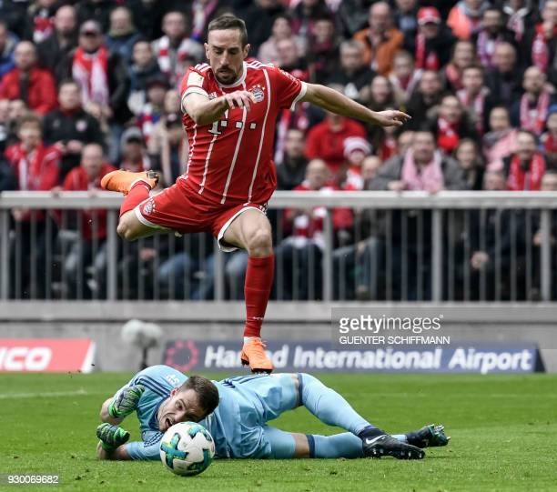 Bayern Munich's French midfielder Franck Ribery jumps over Hamburg's German goalkeeper Christian Mathenia before scoring the first goal during the...