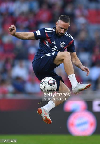 TOPSHOT Bayern Munich's French midfielder Franck Ribery plays the ball during the warm up prior to the German first division Bundesliga football...