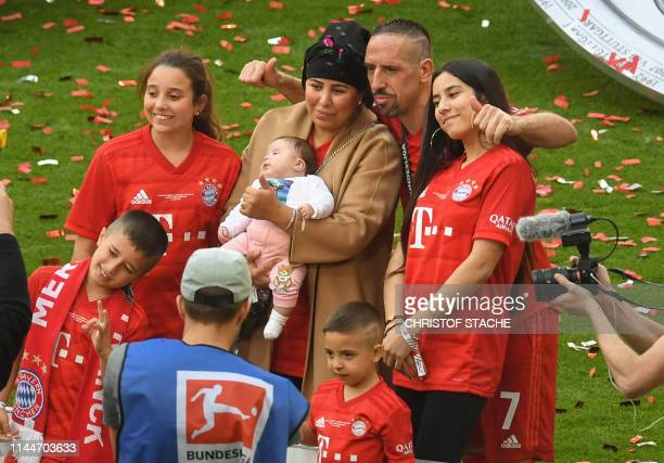 Bayern Munich's French midfielder Franck Ribery poses with his family among them his wife Wahiba Ribery after the German first division Bundesliga...