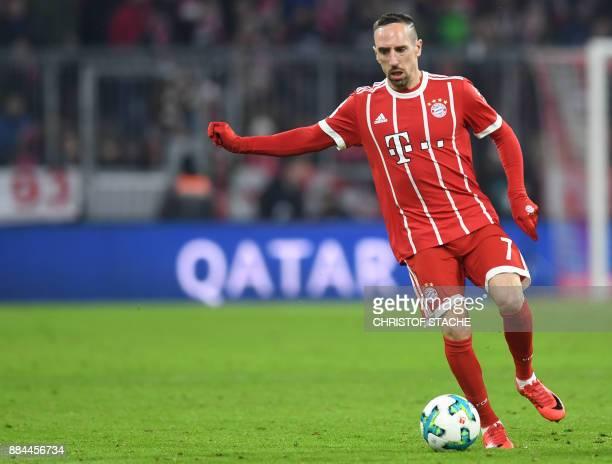 Bayern Munich's French midfielder Franck Ribery runs with the ball during the German First division Bundesliga football match Bayern Munich vs...