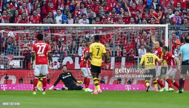 Bayern Munich's French midfielder Franck Ribery scores the opening goal during the German first division Bundesliga football match FC Bayern Munich v...