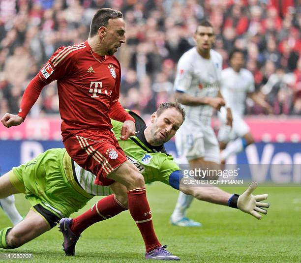 Bayern Munich's French midfielder Franck Ribery scores the seventh goal for his team next to Hoffenheim's goalkeeper Tom Starke during the German...