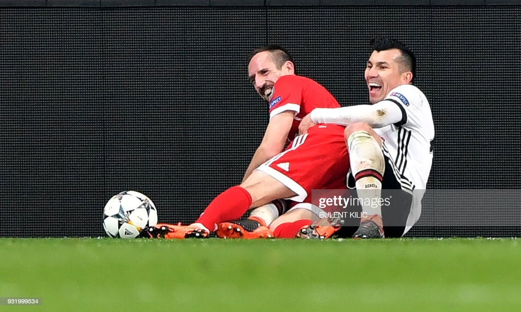 Bayern Munich's French midfielder Franck Ribery (L) shares a light moment after a tackle with Besiktas midfielder Gary Medel during the second leg of the last 16 UEFA Champions League football match between Besiktas and Bayern Munich at Besiktas Park in Istanbul on March 14, 2018. / AFP PHOTO / Bulent Kilic