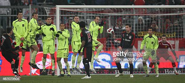 Bayern Munich's French midfielder Franck Ribery shoots a free kick during the Bayern Munich vs Aris Thessaloniki group F UEFA Cup football match in...
