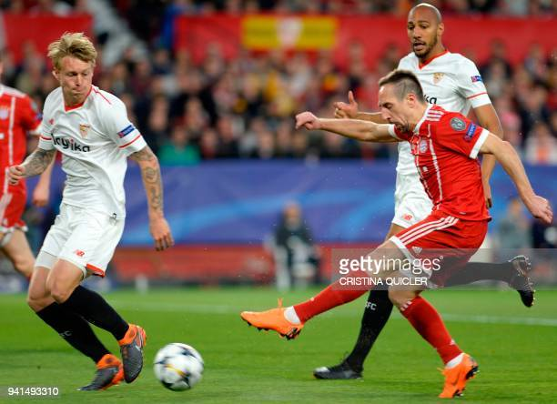 Bayern Munich's French midfielder Franck Ribery shoots beside Sevilla's French midfielder Steven N'Zonzi during the UEFA Champions League...