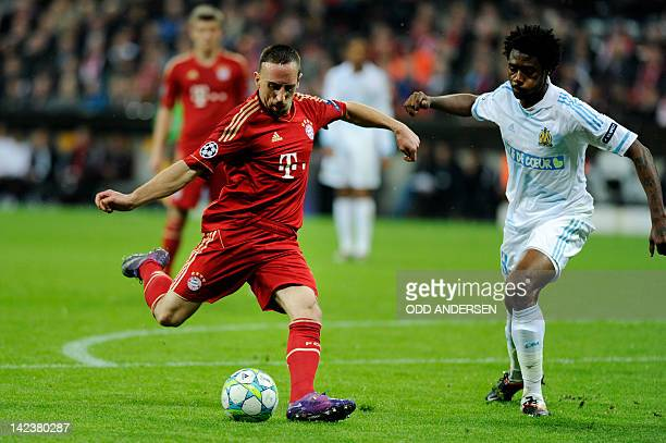 Bayern Munich's French midfielder Franck Ribery shoots past Marseille's Cameroonian defender Nicolas N'koulou during the UEFA Champions League second...