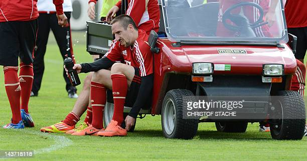 Bayern Munich's French midfielder Franck Ribery sits at a car after a training session of the German first division Bundesliga football team FC...