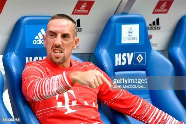 Bayern Munich's French midfielder Franck Ribery sits on the bench prior to the German first division Bundesliga football match between Hamburg SV and...