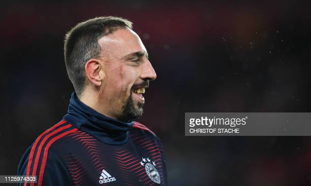 Bayern Munich's French midfielder Franck Ribery smiles prior the UEFA Champions League round of 16 first leg football match between Liverpool and...