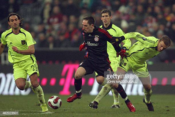 Bayern Munich's French midfielder Franck Ribery vies for the ball against Aris Thessaloniki's defender Avraam Papadopoulos during the Bayern Munich...