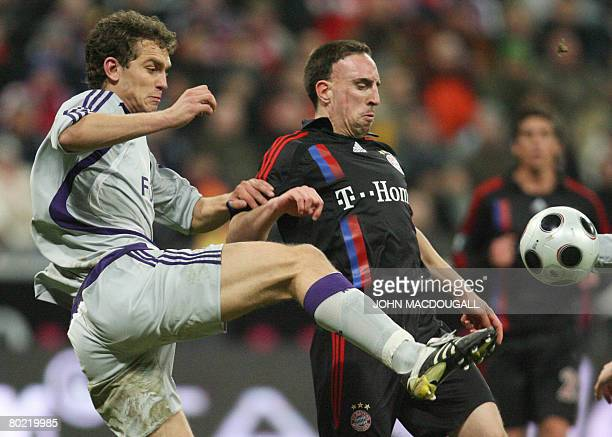 Bayern Munich's French midfielder Franck Ribery vies for the ball against Anderlecht's Hungarian defender Roland Juhasz during the Bayern Munich vs...