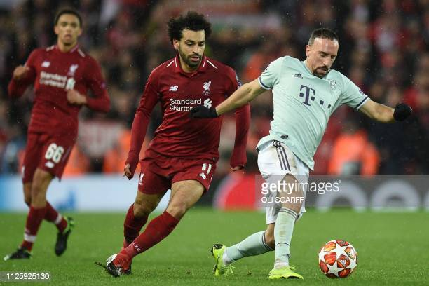 Bayern Munich's French midfielder Franck Ribery vies with Liverpool's Egyptian midfielder Mohamed Salah during the UEFA Champions League round of 16...