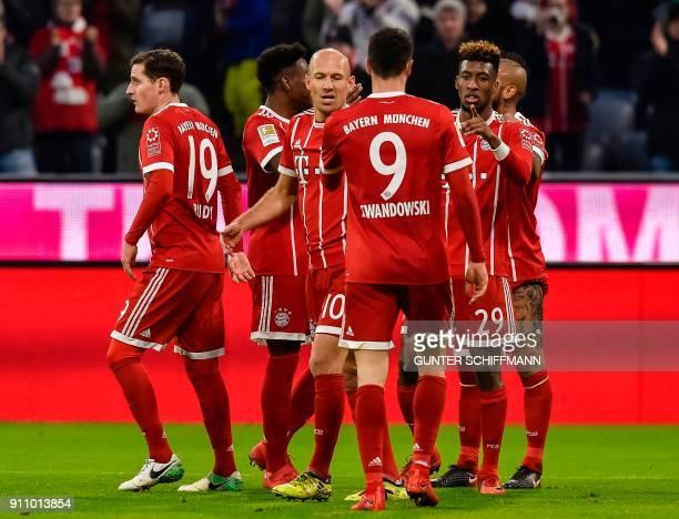 Bayern Munich's French striker Kingsley Coman celebrates his goal during the German first division Bundesliga football match Bayern Munich v TSG 1899...