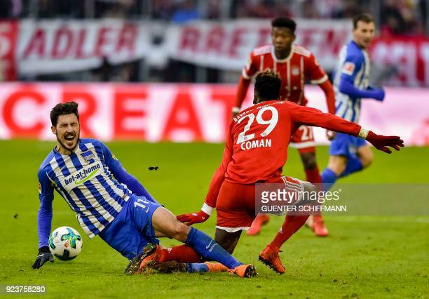 Bayern Munich's French striker Kingsley Coman fouls Berlin's Australian midfielder Mathew Leckie during the German first division Bundesliga football...
