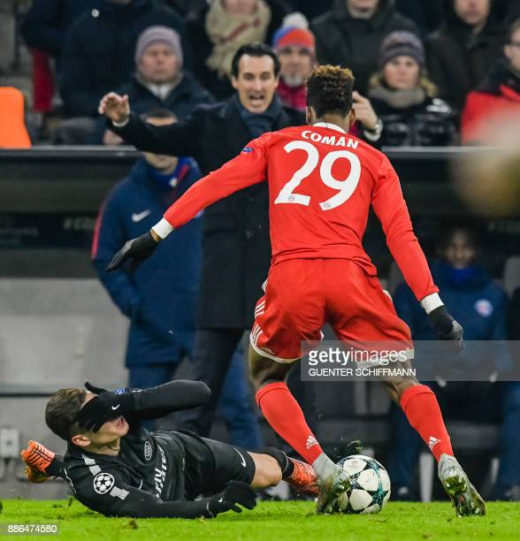 Bayern Munich's French striker Kingsley Coman fouls Paris SaintGermain's German midfielder Julian Draxler during the UEFA Champions League football...