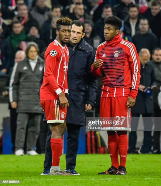 Bayern Munich's French striker Kingsley Coman talks with Bayern Munich's sport director Hasan Salihamizic and Bayern Munich's French forward Kingsley...