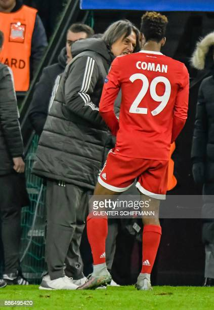 Bayern Munich's French striker Kingsley Coman talks with Bayern Munich's team doctor HansWilhelm MuellerWohlfahrt after the UEFA Champions League...