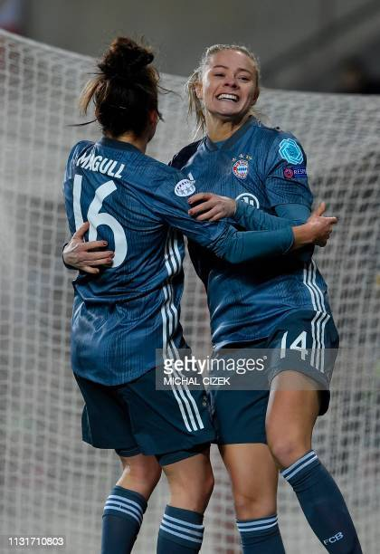 Bayern Munich's Fridolina Rolfo celebrates with her teammate Lina Magull after scoring during the UEFA Women's Champions League quaterfinal first leg...