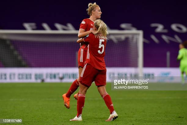 Bayern Munich's German defender Carolin Simon celebrates after scoring a goal during the UEFA Women's Champions League quarter-final football match...