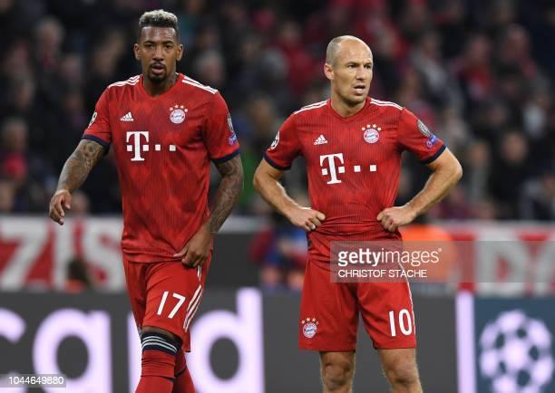 Bayern Munich's German defender Jerome Boateng and Bayern Munich's Dutch midfielder Arjen Robben look on during the UEFA Champions League Group E...