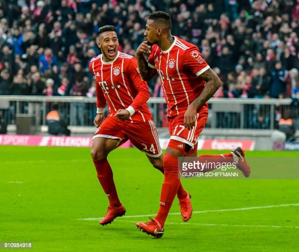 Bayern Munich's German defender Jerome Boateng celebrates with teammates after scoring the second goal during the German first division Bundesliga...