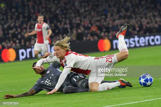 Bayern Munich's German defender Jerome Boateng fouled Ajax's Danish forward Kasper Dolberg in the goal zone during the UEFA Champions League Group E...