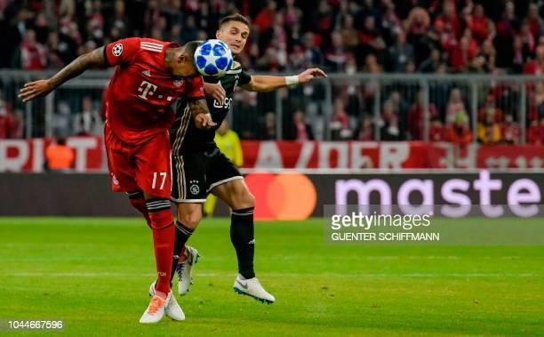 Bayern Munich's German defender Jerome Boateng heads the ball during the UEFA Champions League Group E football match between Bayern Munich and Ajax...