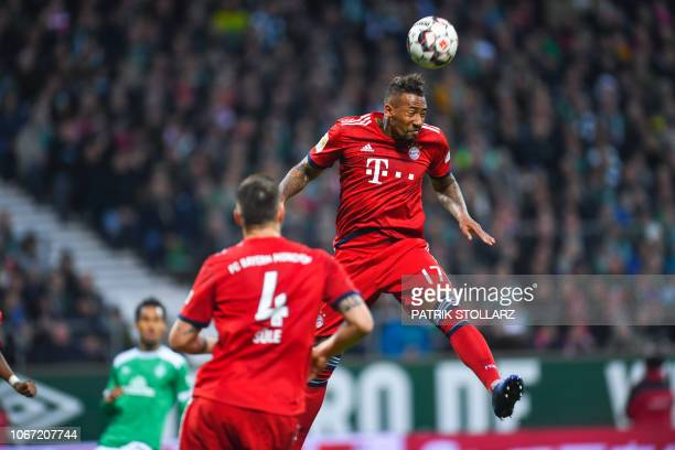 Bayern Munich's German defender Jerome Boateng heads the ball during the German first division Bundesliga football match between Werder Bremen and FC...
