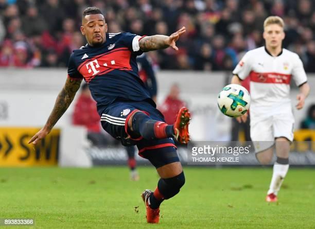 Bayern Munich's German defender Jerome Boateng kicks the ball during the German first division Bundesliga football match between VfB Stuttgart and...