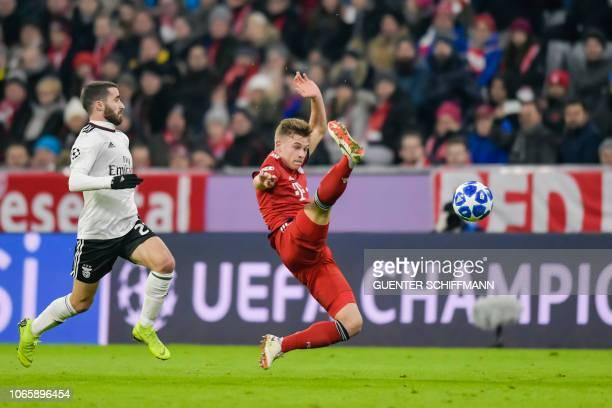 Bayern Munich's German defender Joshua Kimmich kicks the ball during the UEFA Champions League Group E football match Bayern Munich vs Benfica Lisbon...