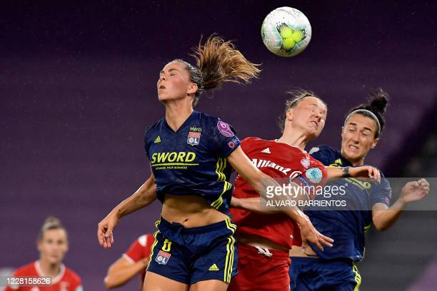 Bayern Munich's German defender Marina Hegering vies with Lyon's Icelandic midfielder Sara Bjork Gunnarsdottir and Lyon's English defender Lucy...