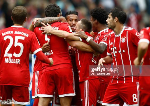 Bayern Munich's German defender Mats Hummels celebrates scoring the opening goal with his teammates during the German first division Bundesliga...