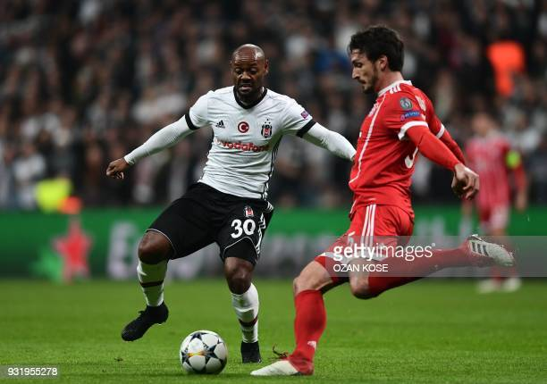 Bayern Munich's German defender Mats Hummels fights for the ball with Besiktas forward Vágner Love during the second leg of the last 16 UEFA...
