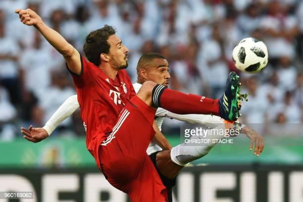 Bayern Munich's German defender Mats Hummels Frankfurt's Ghanaian midfielder KevinPrince Boateng vie for the ball during the German Cup DFB Pokal...