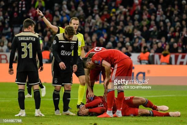 Bayern Munich's German defender Mats Hummels lies on the pitch during the UEFA Champions League Group E football match between Bayern Munich and Ajax...