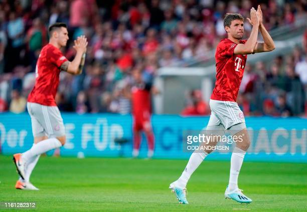 Bayern Munich's German defender Niklas Suele and Bayern Munich's German forward Thomas Mueller arrive on the pitch ahead the German Cup first round...