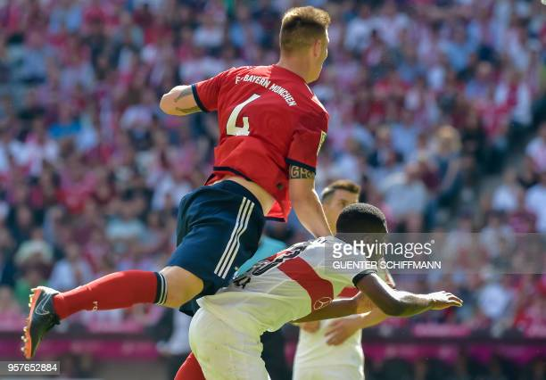 Bayern Munich's German defender Niklas Suele and Stuttgart's Belgian midfielder Orel Mangala vie for the ball during the German first division...