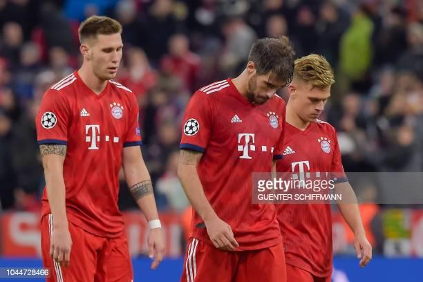 Bayern Munich's German defender Niklas Suele Bayern Munich's Spanish midfielder Javi Martinez and Bayern Munich's German defender Joshua Kimmich...