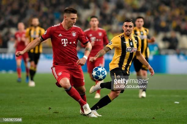 Bayern Munich's German defender Niklas Suele vies with AEK's Belgian midfielder Victor Klonaridis during the UEFA Champions League football match...
