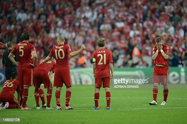 Bayern Munich's German defender Philipp Lahm and Bayern Munich's German midfielder Bastian Schweinsteiger react after the UEFA Champions League final...