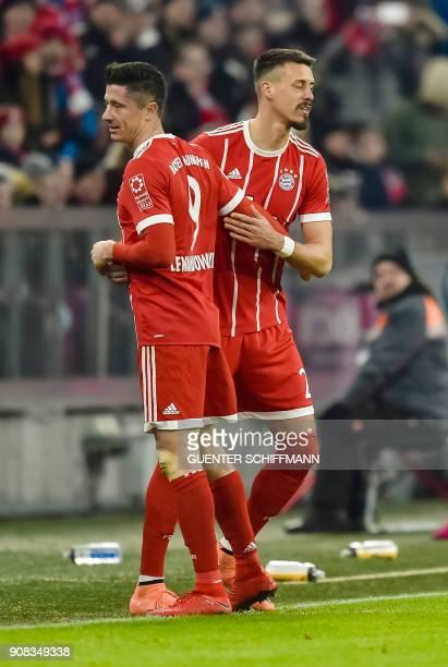 Bayern Munich's German forward Sandro Wagner replaces teammate Polish striker Robert Lewandowski on the pitch during the German first division...