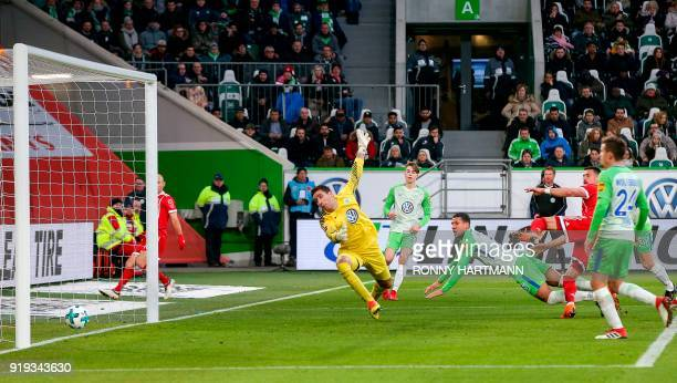 Bayern Munich's German forward Sandro Wagner scores his team's first goal past Wolfsburg's Belgian goalkeeper Koen Casteels during the German first...