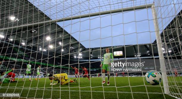 Bayern Munich's German forward Sandro Wagner scores his team's first goal against Wolfsburg's Belgian goalkeeper Koen Casteels during the German...