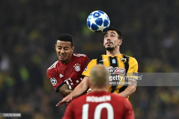 Bayern Munich's German forward Serge Gnabry heads the ball with AEK's Portuguese midfielder Andre Simoes during the UEFA Champions League football...