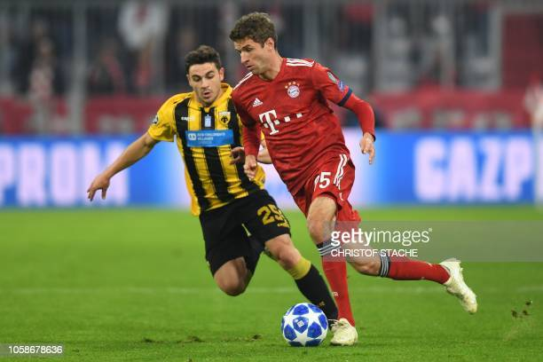 Bayern Munich's German forward Thomas Mueller and AEK's Greek midfielder Kostas Galanopoulos vie for the ball during the UEFA Champions League Group...
